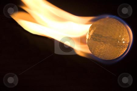 Flaming Golf Ball stock photo, A flaming golf ball rocketing through space. by Robert Byron