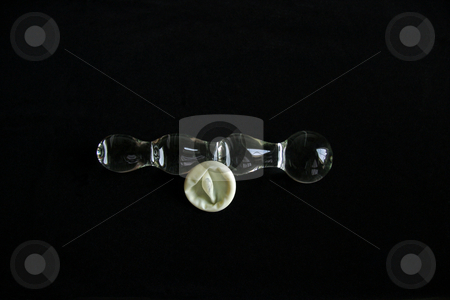 Glass Sex Toy on black stock photo, A bumpy glass sex toy or dildo with a condom by Kevin Tietz