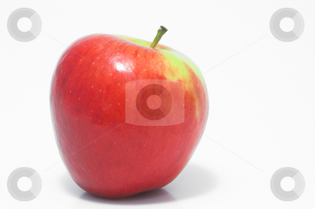 Red Delicious Apple stock photo, A whole red delicious apple waiting to be eaten. by Robert Byron