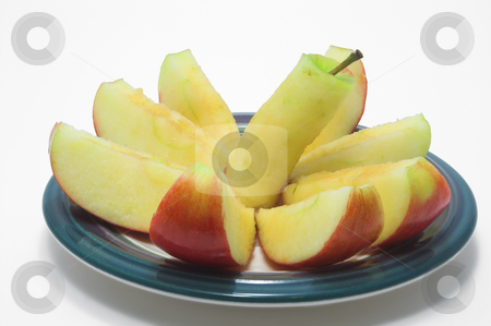 Sliced Red Apple stock photo, A red delicious apple sliced on a plate. by Robert Byron