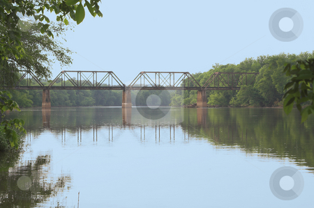 Train Trestle stock photo, An old vintage train trestle over a river. by Robert Byron