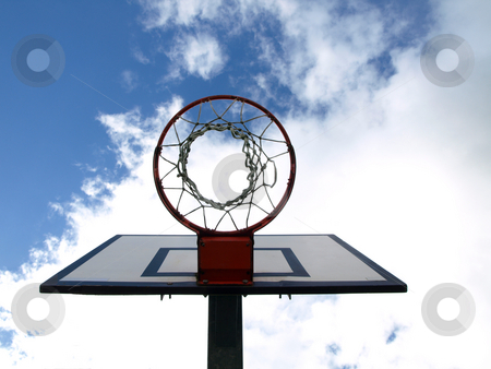 Scoring stock photo, Basketball hoop under blue sky with clouds by Laurent Dambies