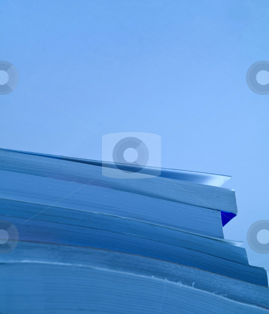 School books pile stock photo, Blue tinted closeup shot a pile of books with copy space by Laurent Dambies