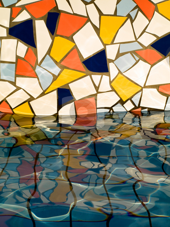 Colorful wall in water stock photo, Fountain wall closeup with colorful tiles reflecting in water by Laurent Dambies