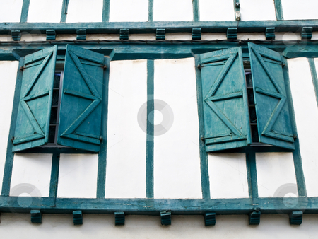 Green wooden wall windows stock photo, Traditional house wall in the Basque village of Espelette by Laurent Dambies