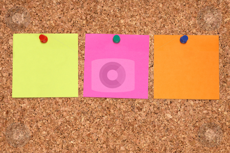 Three colorful blank notes on a notice board. stock photo, Three colorful blank notes on a notice board. by Stephen Rees