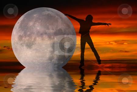 Dancing with the moon stock photo, Silhouette of a woman dancing with the moon over the ocean by Serge VILLA