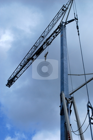 Crane and clouds stock photo, Crane on a cloudy day by Robert Cabrera
