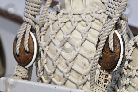 Vintage sailboat detail stock photo, Close-up of old blocks on an sailboat with bumpers covered of rope net by Massimiliano Leban