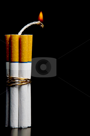 Cigarette Bomb stock photo, Several cigarettes bound together like sticks of dynamite. by Robert Byron