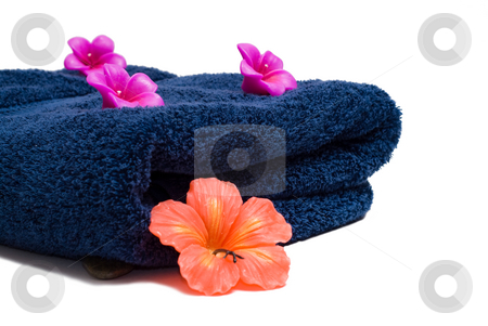 Aroma Therapy Candles stock photo, Two different flowered candles and a towel used for aroma therapy by Richard Nelson
