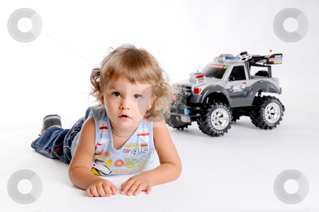 Boy and Toy Car stock photo, Little Curly-headed Boy and Toy Car by Valeriy Mazur