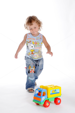 Boy and Toy Car 3 stock photo, Little Curly-headed Boy and Toy Car by Valeriy Mazur