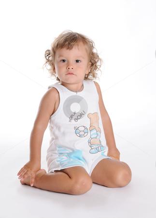 Sitting Boy stock photo, Little Curly-headed Brown Eyed Boy by Valeriy Mazur
