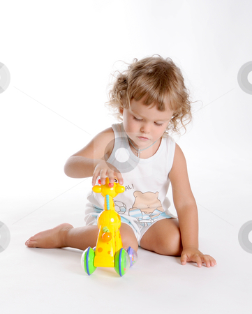 Boy and Giraffe stock photo, Little Curly-headed Boy and Toy Giraffe by Valeriy Mazur