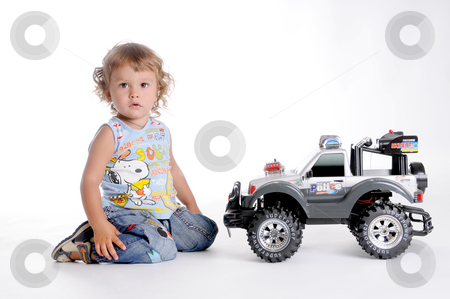 Boy and Toy Car 2 stock photo, Little Curly-headed Boy and Toy Car by Valeriy Mazur