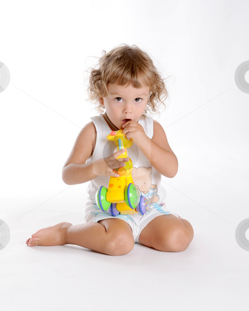 Boy and Giraffe 2 stock photo, Little Curly-headed Boy and Toy Giraffe by Valeriy Mazur