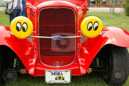 1930 Red Ford Coupe with Eyes stock photo, A red 1930 Ford coupe streetrod with special headlamp covers grabbed a lot of attention at the spring Pequot Lakes, MN Classic Car Show. by Dennis Thomsen