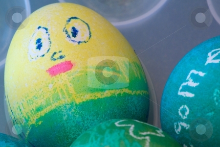 Happy Egg stock photo, Close-up of dyed Easter eggs. by Charles Jetzer