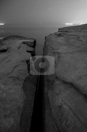 Fading rock stock photo, Yellow Filtered, black and white, night shot of sunset cliffs by John Adair