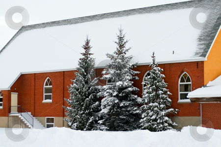 Snow Church stock photo, Snow covered church with trees in front by Johan Knelsen