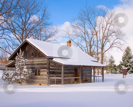 Log cabin stock photo, Log cabin in the winter with snow covering the roof and the ground by Johan Knelsen