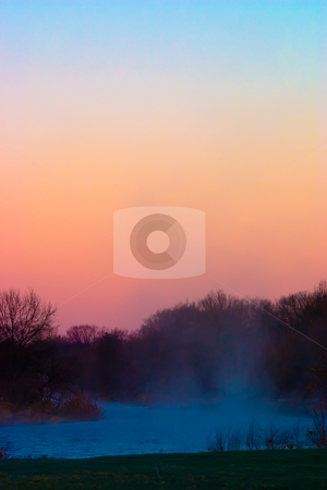 River Fog stock photo, Fog rising from a river at dawn one morning by Johan Knelsen