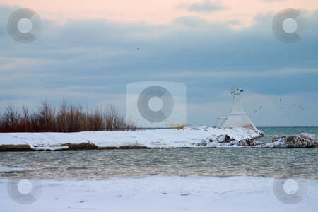 Light House In The Winter stock photo, Light house in a bay on a coast with snow in the foreground by Johan Knelsen