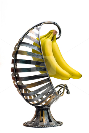 Side Banana Basket stock photo, Isolated bananas in a banana basket on the side view by Johan Knelsen