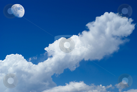 Deep blue stock photo, The moon over the clouds by Serge VILLA