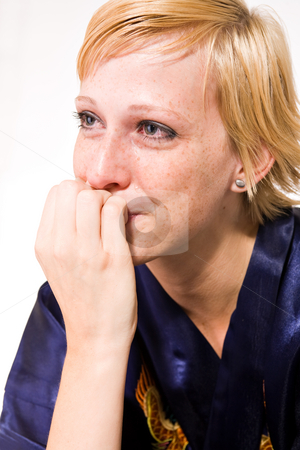 Blond girl with short hair in tears stock photo, Studio portrait of a short haired blond girl crying by Frenk and Danielle Kaufmann