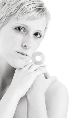 Blond in black and white flirting with you stock photo, Serene portrait of a blond girl making eye contact by Frenk and Danielle Kaufmann