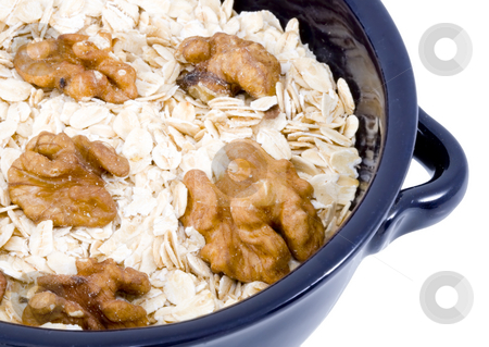 Bowl of Oatmeal stock photo, A bowl of oatmeal with walnuts - healthy diet by Petr Koudelka