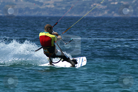 Kite Boarder stock photo, Kite boarder on run at full speed by Serge VILLA