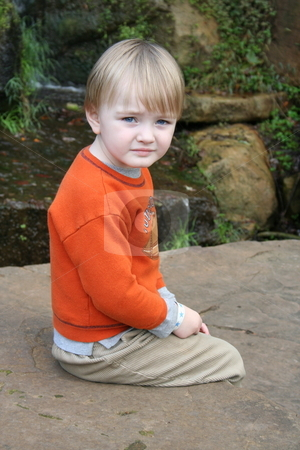 Little Boy Sitting by Waterfall stock photo, Little boy sitting on the rocks by a waterfall by Debbie Hayes
