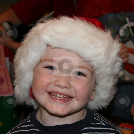 Little Boy at Christmas Time stock photo, Little boy at Christmas time wearing a Santa hat and smiling by Debbie Hayes