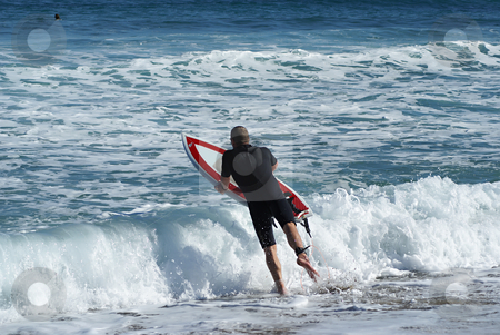 Jumping in the wave stock photo, Surfer leaving the beach (French Riviera) by Serge VILLA