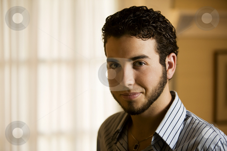 Portrait of a Young Man  stock photo, Portrait of a Handsome Young Man Indoors by Scott Griessel