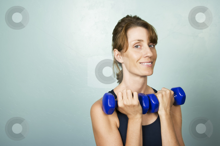 Woman Exercising with Dumbells stock photo, Athletic Woman Exercising with small Blue Dumbells by Scott Griessel