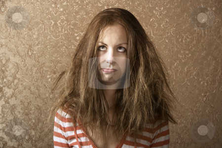 Young Woman with Messy Hair stock photo, Portrait of a young woman with messy long hair by Scott Griessel