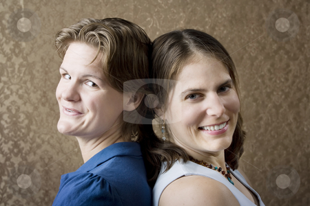 Two Women stock photo, Portrait of Two Young Women Friends Back to Back by Scott Griessel