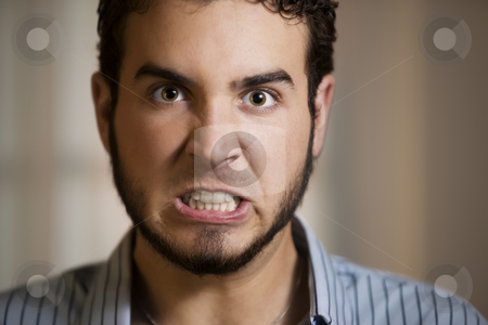 Young Man with Clenched Teeth stock photo, Close Up of Angry Young Man with Clenched Teeth by Scott Griessel