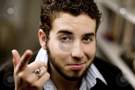 Handsome Young Man stock photo, Portrait of handsome young man with beard gesturing with his hand by Scott Griessel