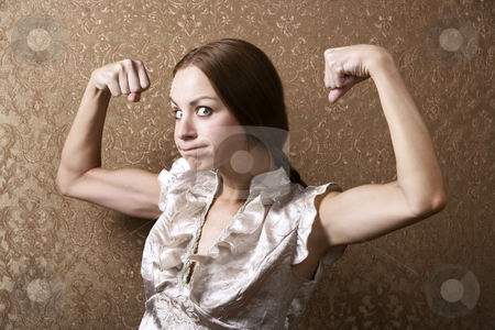 Young Woman Flexing Her Biceps stock photo, Portrait of a Pretty Young Woman Flexing Her Biceps by Scott Griessel