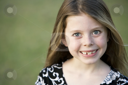 Pretty Young Girl with Crooked Teeth stock photo, Pretty Young Girl with Freckles and a Big Smile and Crooked Teeth by Scott Griessel