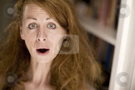 Woman making a funny face stock photo, Woman with big hair making a funny expression by Scott Griessel