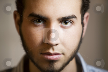 Closeup Shot of a Young Man stock photo, Closeup Shot of Young Man with Beard and Brown Eyes by Scott Griessel