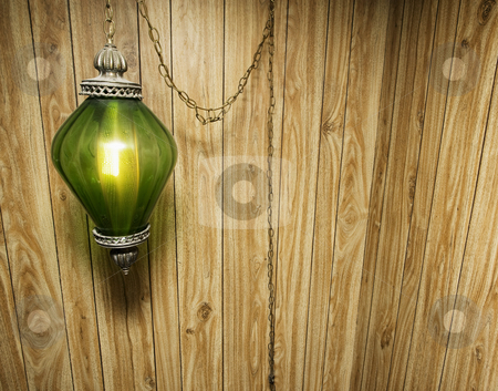 Wood Paneling and Hanging Lamp stock photo, Groovy Wood Paneling and Hanging Green Lamp background by Scott Griessel