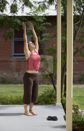 Yoga Mountain pose stock photo, Pretty Young Woman doing Yoga on a Porch by Scott Griessel