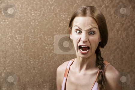 Screaming Woman stock photo, Screaming Young Woman in front of Gold wallpaper by Scott Griessel